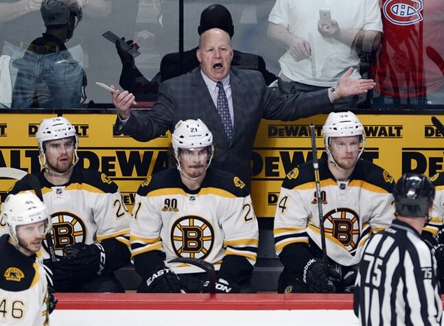 Boston Bruins head coach Claude Julien yells at the referee during third period NHL second round Stanley Cup playoff action on Monday, May 12, 2014 in Montreal.THE CANADIAN PRESS/Ryan Remiorz