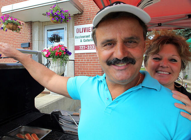 Paul and Susan Spiropoulos stand together at Olivier's Bistro Catering and BBQ at Princess Park on Thursday.