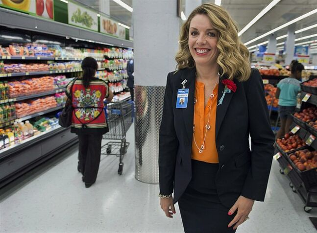 Walmart Canada CEO Shelley Broader attends the opening of the company's new Supercentre in Halifax on Friday, July 26, 2013. The Supercentre will add fresh food, putting competitive pressure on other grocery retailers. Walmart is opening 35 more Canadian supercentres as part of nearly $500 million in planned investments over the next year as the U.S. retailing giant keeps competitive pressure on its rivals. THE CANADIAN PRESS/Andrew Vaughan
