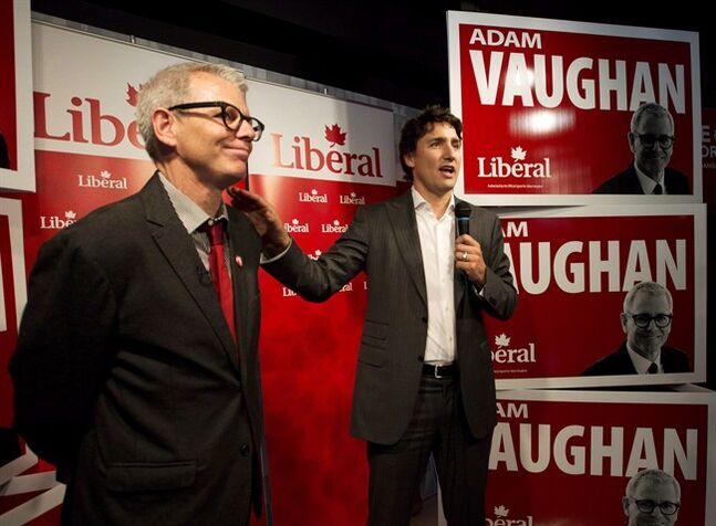 Federal Liberal leader Justin Trudeau, right, speaks to supporters with candidate for the Trinity-Spadina riding Adam Vaughan, left, during a campaign stop in Toronto on Thursday, May 22, 2014. THE CANADIAN PRESS/Nathan Denette