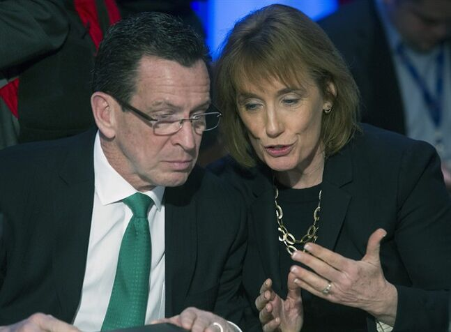 Connecticut Gov. Dannel Malloy, left, talks with New Hampshire Gov. Maggie Hassan while they participate in a special session on jobs in America during the National Governor's Association Winter Meeting in Washington, Sunday, Feb. 23, 2014. (AP Photo/Cliff Owen)