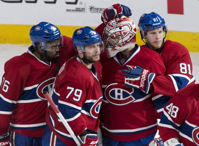 Montreal Canadiens' P.K. Subban (left to right), Andrei Markov, Carey Price and Lars Eller, celebrate their victory over the Boston Bruins in NHL playoff hockey action on Monday, May 12 in Montreal.
