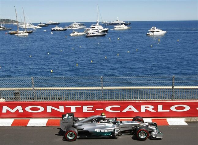 Mercedes driver Nico Rosberg of Germany steers his car during the qualifying session at the Monaco racetrack, in Monaco, Saturday, May 24, 2014. Nico Rosberg has taken pole position for the Monaco Grand Prix ahead of his Mercedes teammate Lewis Hamilton and Red Bull's Daniel Ricciardo. Alonso will start for the fifth position. The Monaco Formula One Grand Prix will be held on Sunday. (AP Photo/Claude Paris)