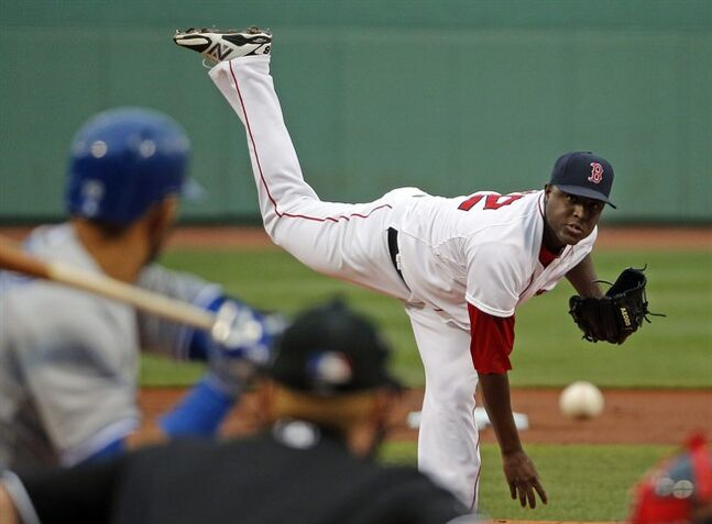 Boston Red Sox starting pitcher Rubby De La Rosa delivers to the Toronto Blue Jays during the first inning of a baseball game at Fenway Park in Boston, Tuesday, July 29, 2014. (AP Photo/Elise Amendola)