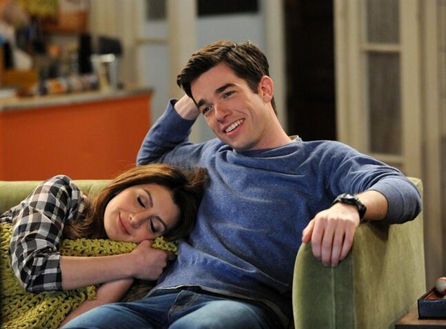 This image released by Fox shows Nasim Pedrad, left, and John Mulaney in a scene from the comedy,