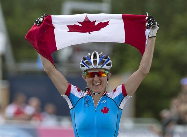 Canada's Catharine Pendrel races to gold in the women's cross-country event at Cathkin Braes mountain bike trails at the Commonwealth Games in Glasgow, Scotland on Tuesday, July 29, 2014. THE CANADIAN PRESS/Andrew Vaughan