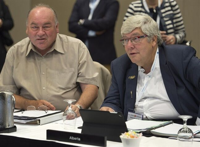 Yukon Premier Bob McLeod, left, and Alberta Premier Dave Hancock attend a session at the annual Council of the Federation meeting in Charlottetown on Friday, August 29, 2014. THE CANADIAN PRESS/Andrew Vaughan