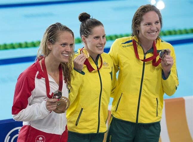 Canada's Hilary Caldwell, left, displays her bronze medal along with Australia's Belinda Hocking, gold and Australia's Emily Seebohm, silver medallist, in the women's 200 metre backstroke event at the Tollcross Swimming Centre at the Commonwealth Games in Glasgow, Scotland on Sunday, July 27, 2014. THE CANADIAN PRESS/Andrew Vaughan