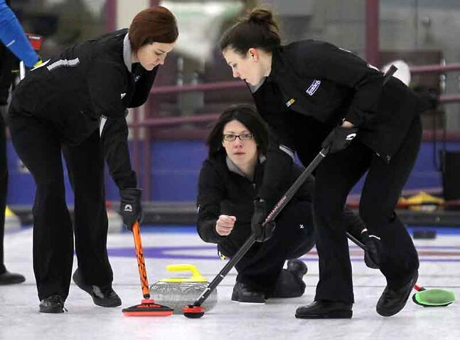 Skip Liza Park, with Kortney Teale (left) and Pam Robins, takes a shot in Brandon Curling Club play last week.