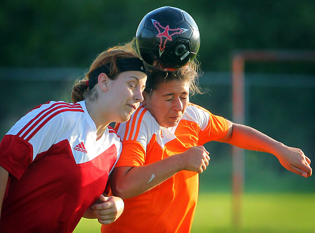 Sydney Carter-Squire (left) of the Brandon Chaos and Melissa Zorzos of the Brandon Crush battle to head the ball in Westman Women's Soccer League action on Thursday evening at the Kirkcaldy School soccer pitch.