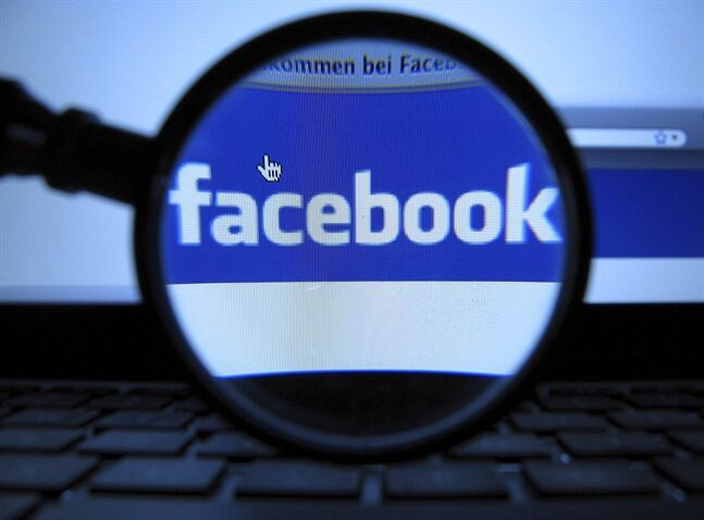A magnifying glass is posed over a monitor displaying a Facebook page in Munich on Oct. 10, 2011. Facebook is being more proactive in ensuring its users fully understand their privacy settings and who can see their posts. THE CANADIAN PRESS/AP, dapd, Joerg Koch