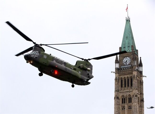 A Canadian Forces CH-147 Chinook helicopter prepares to land on Parliament Hill in Ottawa Thursday May 8, 2014 in preparation for Canada's National Day of Honour taking place Friday. THE CANADIAN PRESS/Fred Chartrand