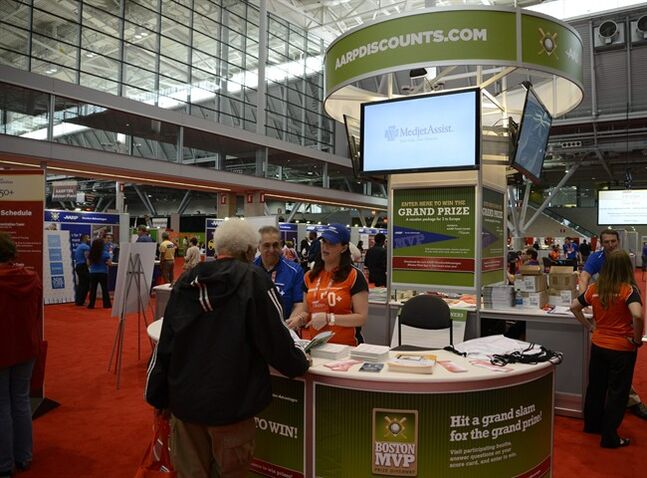 This May 10, 2014 photo provided by AARP Life@50+ shows exhibitors promoting discount offers to conference attendees at the AARP Life@50+ National Member Event held May 8-10, 2014, in Boston. The last of the Baby Boomers turns 50 this year, and if they want to cry into their beer about getting older, at least they can now buy it at a discount. The first of the so-called senior discounts kick in at age 50, generally along with an AARP card. (AP Photo/AARP Life@50+)
