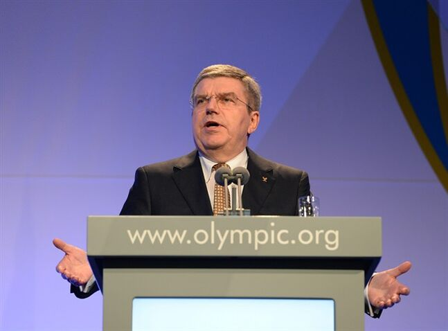 President of the International Olympic Committee Thomas Bach delivers his speech at the IOC Gala Dinner on the eve of the opening ceremony of the 2014 Winter Olympics, Thursday, Feb. 6, 2014, in Sochi, Russia. (AP Photo/Andrej Isakovic, Pool)