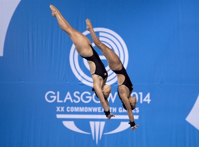 Canada's Meaghan Benfeito and Roseline Filion compete in the women's synchronised 10-metre platform event at Royal Commonwealth Pool in Commonwealth Games action in Edinburgh, Scotland on Wednesday, July 30, 2014. Canada won gold. THE CANADIAN PRESS/Andrew Vaughan