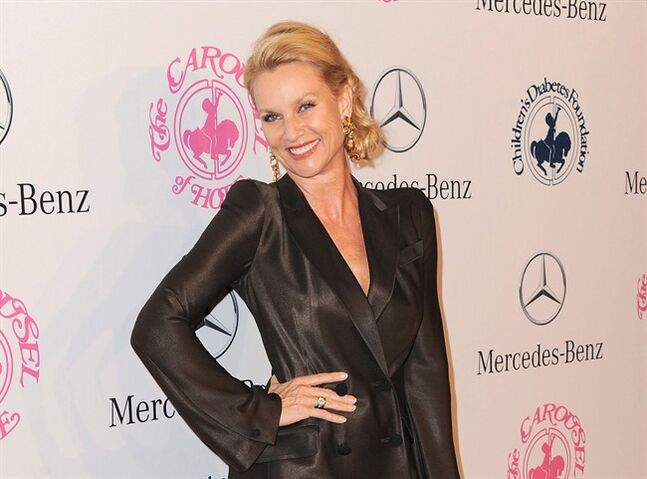 FILE - In this Oct. 20, 2012 file photo, Nicollette Sheridan arrives at The Carousel of Hope at The Beverly Hilton Hotel, in Beverly Hills. A Los Angeles judge on Wednesday, Jan. 29, 2014, reversed an earlier ruling dismissing Sheridan's lawsuit over her departure from the hit ABC series,
