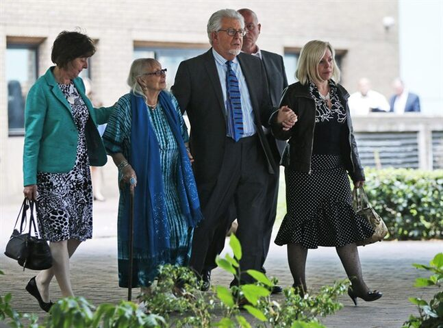 Veteran entertainer Rolf Harris, centre right, accompanied by his daughter Bindi, right, wife Alwen, second left, and niece Jenny leave the Southwark Crown Court in London, Monday, June 30, 2014. A jury Monday found Australian-born Harris guilty of 12 counts of indecent assault. The 84-year-old was convicted of indecent assault on four victims aged 19 or under between 1968 and 1986. Harris was a prominent British broadcaster for decades and once performed with the Beatles. He had denied the charges. (AP Photo/Lefteris Pitarakis)