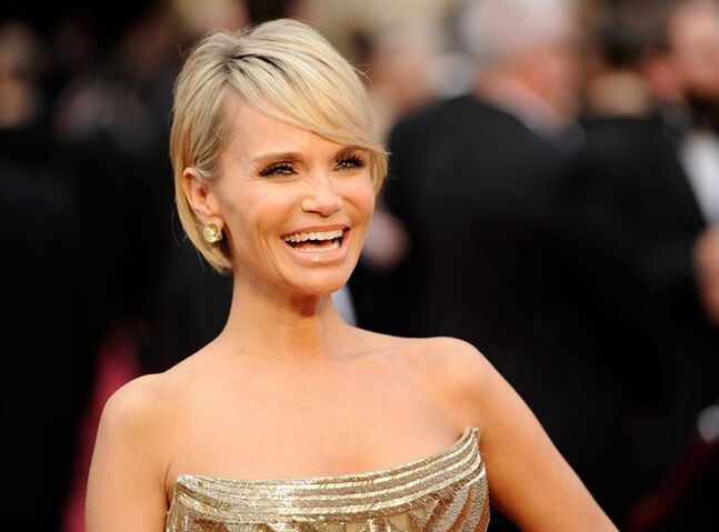 "FILE - This March 2, 2014 file photo shows actress Kristin Chenoweth at the Oscars in Los Angeles. Chenoweth is chugging back to Broadway in the stylish screwball musical ""On the Twentieth Century."" Producers said Tuesday, May 13, 2014, that the Tony- and Emmy-winner will co-star with Peter Gallagher in the show adaptred from the the 1934 film with lyrics by Betty Comden and Adolph Green and music by Cy Coleman. Scott Ellis will direct and Warren Carlyle will choreograph. (Photo by Chris Pizzello/Invision/AP, FIle)"