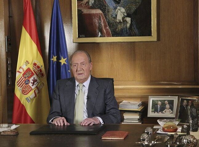 In this photo released by the Royal Palace on Monday June 2, 2014 and distributed by Spain's national agency EFE, Spain's King Juan Carlos makes a televised speech Monday in the Zarzuela Palace in Madrid announcing his abdication. Spain's King Juan Carlos plans to abdicate and pave the way for his son, Crown Prince Felipe, to take over, Spanish Prime Minister Mariano Rajoy told the country Monday in an announcement broadcast nationwide. The 76-year-old Juan Carlos oversaw his country's transition from dictatorship to democracy but has had repeated health problems in recent years. (AP Photo/Spanish Royal Palace/EFE)
