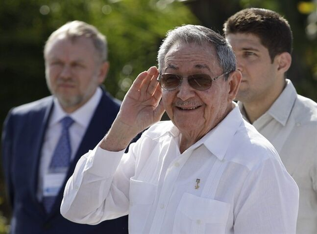 Cuba's President Raul Castro, center, cups his hand to ear his ear to better hear a reporter's question outside the Internationalist Soviet soldier mausoleum where he attended a tribute with the visiting Prime Minister of Russia, Dmitry Medvedev, in Havana, Cuba, Friday, Feb. 22, 2013. The Cuban leader raised the possibility of leaving his post, during an appearance Friday. Castro told reporters he's about to turn 82 years old and added,
