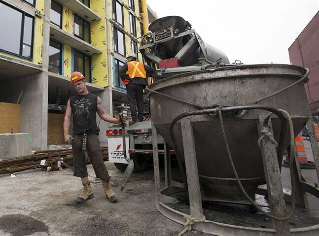 Construction workers are pictured July 2, 2013 in Montreal.THE CANADIAN PRESS/Ryan Remiorz
