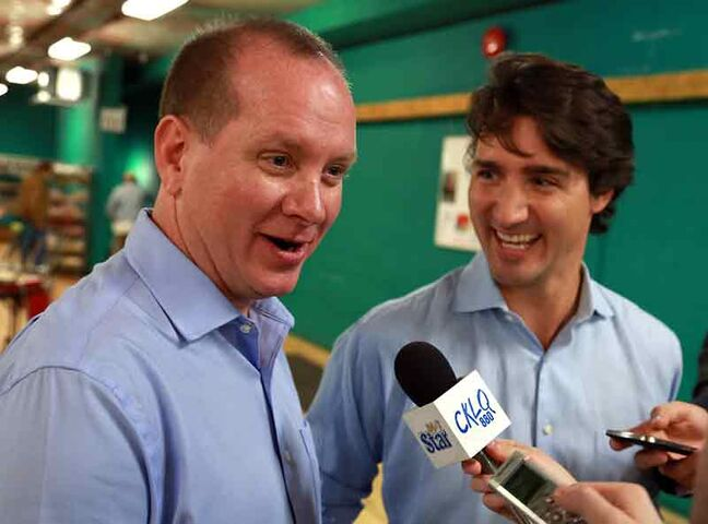 Rolf Dinsdale and Justin Trudeau share a light moment in Brandon earlier this month.