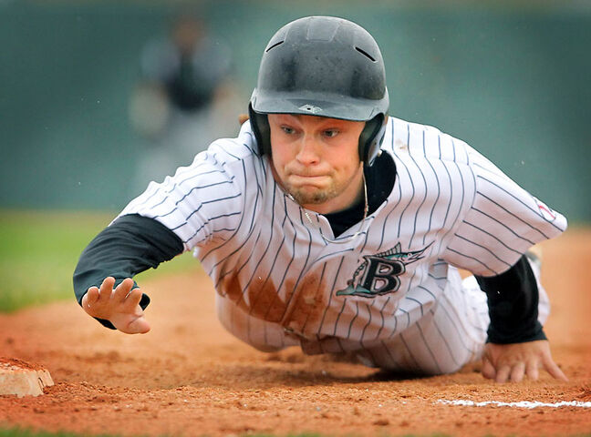 Brandon Marlins' Nolan Jago dives back to first base to avoid the pickoff attempt in the bottom of the first inning against the Brandon Cloverleafs Tuesday at Andrews Field. The Cloverleafs won the Manitoba Senior Baseball League game 10-1. (Colin Corneau/Brandon Sun)