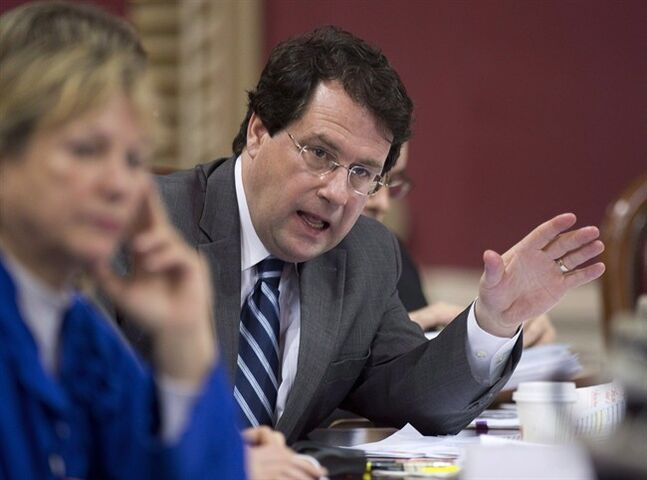 Bernard Drainville speaks at a legislature committee studying the proposed values charter January 15, 2014 in Quebec City. THE CANADIAN PRESS/Jacques Boissinot