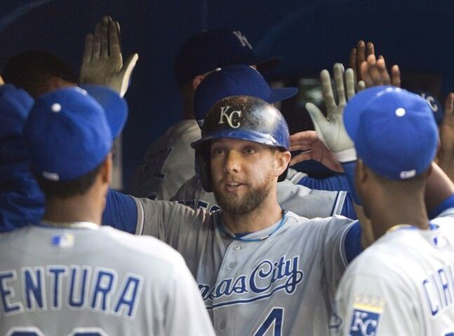 Kansas City Royals' Alex Gordon is congratulated for a two run home run in Toronto Friday May 30, 2014. THE CANADIAN PRESS/Fred Thornhill