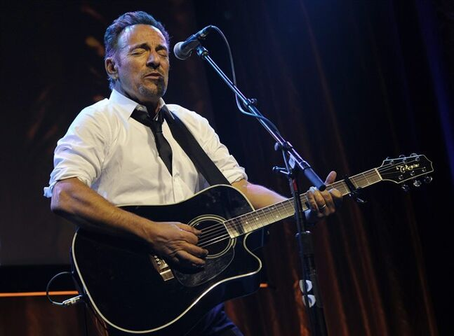 "FILE - In this Thursday, May 8, 2014, file photo, Bruce Springsteen performs during the USC Shoah Foundation's 20th anniversary Ambassadors for Humanity gala in Los Angeles. Springsteen is getting into the picture book business. ""Outlaw Pete,"" based on a ballad from Springsteen's ""Working on a Dream"" album, will be published by Simon & Schuster on Nov. 4, 2014. The book will feature Springsteen's lyrics and illustrations by Frank Caruso, Simon & Schuster announced Thursday, Aug. 28. (AP Photo/Susan Walsh, File)"