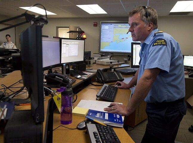 A Canadian Coast Guard officer works at the Joint Rescue Coordination Centre in Halifax on May 2, 2013. THE CANADIAN PRESS/Andrew Vaughan