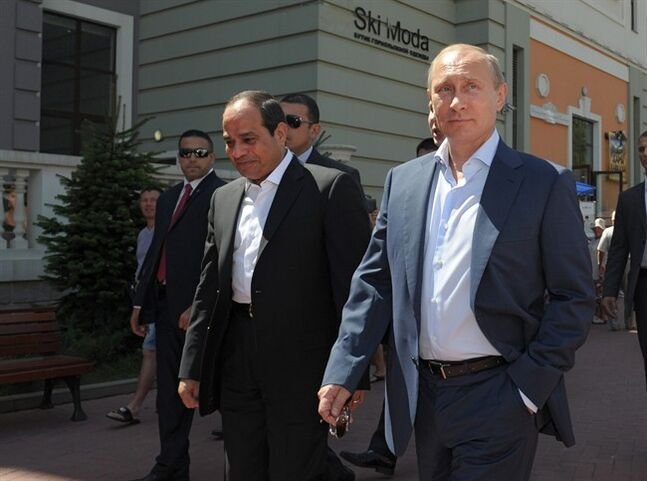Russian President Vladimir Putin, right, and Egyptian President Abdel-Fattah el-Sissi, front left, visit the Rosa Khutor mountain village near the Russian Black Sea resort of Sochi, Russia, Tuesday, Aug. 12, 2014. El-Sissi is his the first official visit to Russia as President. (AP Photo/RIA Novosti, Alexei Druzhinin, Presidential Press Service)