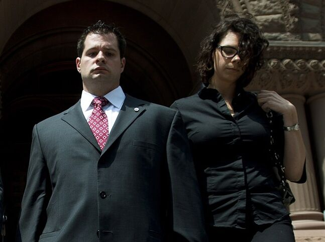 Const. James Forcillo, left, and his wife Irina Forcillo, right leave the Old City Hall court house in Toronto on Tuesday, June 17, 2014. Forcillo has been committed to stand trial on a charge of second-degree murder in the shooting death of a teenager on a Toronto streetcar last summer.THE CANADIAN PRESS/Nathan Denette