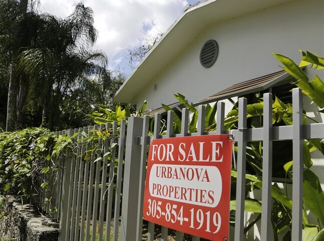 This Monday, May 19, 2014 photo shows a duplex home for sale in the Coconut Grove neighborhood in Miami. Freddie Mac releases weekly mortgage rates on Thursday, July 3, 2014. (AP Photo/Lynne Sladky)