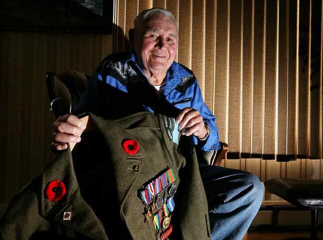 Second World War veteran Francis Goodon sits in his home in Boissevain with his military jacket displaying some of his medals. Gooden was captured by Hitler's army after he and the rest of the Allied forces stormed Juno Beach in what is now known as D-Day.