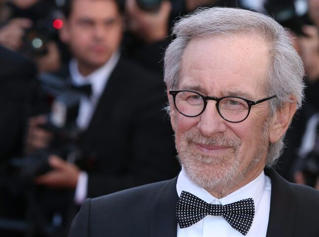 "In this May 25, 2013 file photo, jury president, director Steven Spielberg, arrives for the screening of the film Venus in Fur at the 66th international film festival, in Cannes, southern France. Spielberg's next two films have been slated for October 2015 and July 2016. DreamWorks announced Monday, June 16, 2014, that an untitled Cold War spy thriller from Spielberg will open October 16 next year, and ""The BFG"" is planned for July 1, 2016. (Photo by Joel Ryan/Invision/AP, file)"