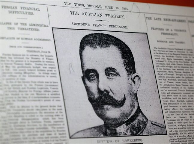 This April 4, 2014 photo shows a reproduction of a London newspaper front page from 1914, which writes about the assassination of Archduke Franz Ferdinand, at the National World War I Museum in Kansas City, Mo. On the last Sunday of June in 1914, a 19-year-old student fired two pistol shots that killed the Austrian Archduke Franz Ferdinand and his wife, Sophie. The echoes of those shots have never really died away. THE CANADIAN PRESS/AP, Charlie Riedel