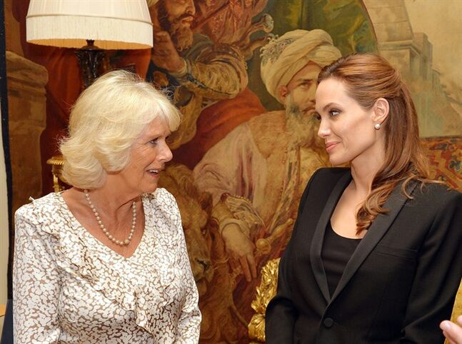 Camilla, Duchess of Cornwall, left, meets Angelina Jolie, as the actress talked about her campaign against sexual violence in war zones during a meeting, at Clarence House, London, Thursday June 12, 2014. (AP Photo/John Stillwell, Pool)