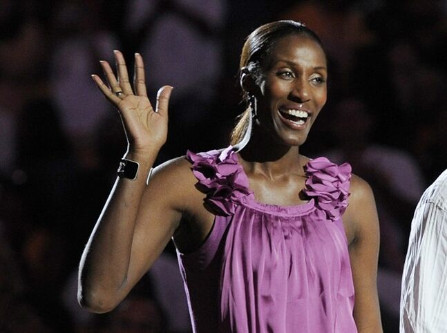 FILE - This Aug. 10, 2010, file photo shows retired Los Angeles Sparks basketball player Lisa Leslie waving to the crowd during a ceremony to retire her jersey at halftime of a WNBA basketball game between the Indiana Fever and the Sparks in Los Angeles. CBS Sports Network will air an all-women sports show starting next month. CBS said Tuesday, Aug. 26, 2014, the weekly hour-long, prime-time program on the cable channel will be the first of its kind.