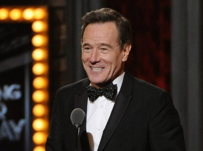 "FILE - This June 8, 2014 file photo shows Bryan Cranston accepting the award for best performance by an actor in a leading role in a play for ""All The Way"" on stage at the 68th annual Tony Awards at Radio City Music Hall in New York. Cranston, Julia Roberts, and Gwen Stefani are among a group of presenters announced for the Emmy Awards on Aug. 25. (Photo by Evan Agostini/Invision/AP, File)"