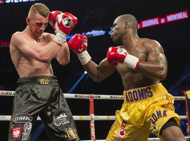 Adonis Stevenson right, and Andrzej Fonfara battle in a WBC light heavyweight title bout in Montreal on Saturday, May 24, 2014. THE CANADIAN PRESS/Peter McCabe