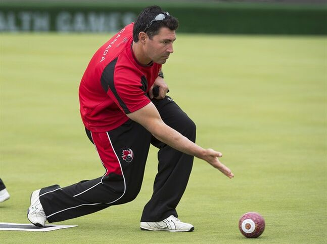 Lawn bowler Tim Mason practices at the Kelvingrove Lawn Bowls Centre at the Commonwealth Games in Glasgow, Scotland on Tuesday, July 22, 2014. Mason took up the sport ten years ago after taking a wrong turn on the way to a community centre while looking for a gymnasium. A decade later he is bowling for Canada at the games. THE CANADIAN PRESS/Andrew Vaughan
