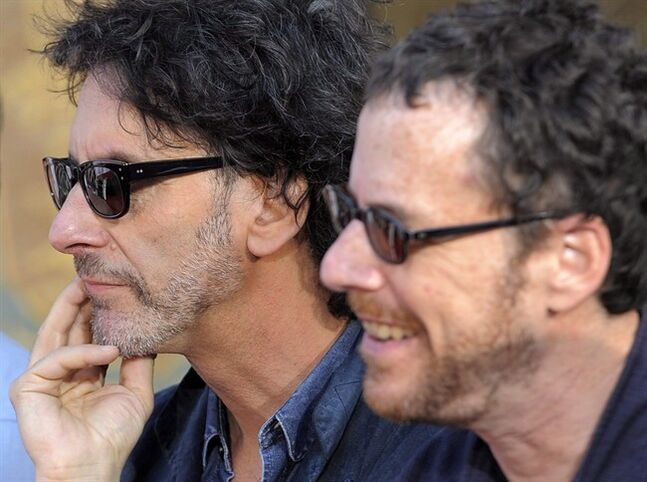 Film director brothers Joel Coen, left, and Ethan Coen, look on during a hand and footprint ceremony for actor John Goodman in Los Angeles, on Thursday, Nov. 14, 2013. THE CANADIAN PRESS/AP-Chris Pizzello/Invision/AP
