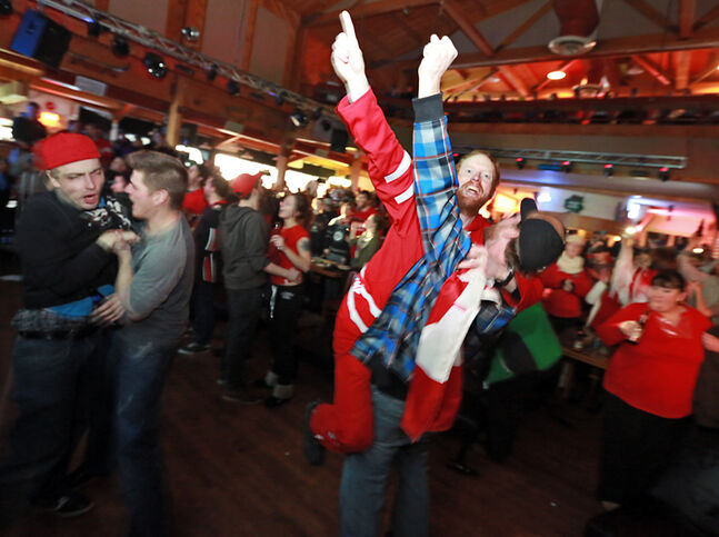 "Dallas ""Sallard"" Bridgeman roars along with the crowd at Houstons Country Roadhouse as the Canadian men's hockey team wins an Olympic gold medal in the wee hours of Sunday morning. Nearly 400 Brandonites came together before the sun rose to watch Team Canada shut out Sweden 3-0 to close off the Sochi Winter Games."