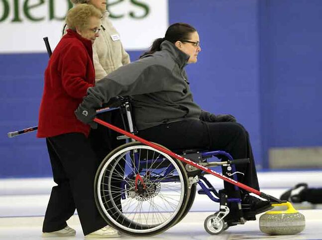 Heather Mowat competes with her team during senior women's curling action at the Brandon Curling Club on Thursday afternoon. Mowat was confined to a wheelchair after a rollover but started curling again two years ago. Mowat is moving with her husband to Germany in the new year, making Thursday's game her last curling match in Manitoba.