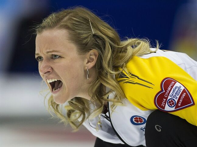 Team Manitoba skip Chelsea Carey shouts after delivering her rock to team Quebec during draw 12 curling action at the Scotties Tournament of Hearts competition in Montreal, Wednesday, February 5, 2014. THE CANADIAN PRESS/Graham Hughes