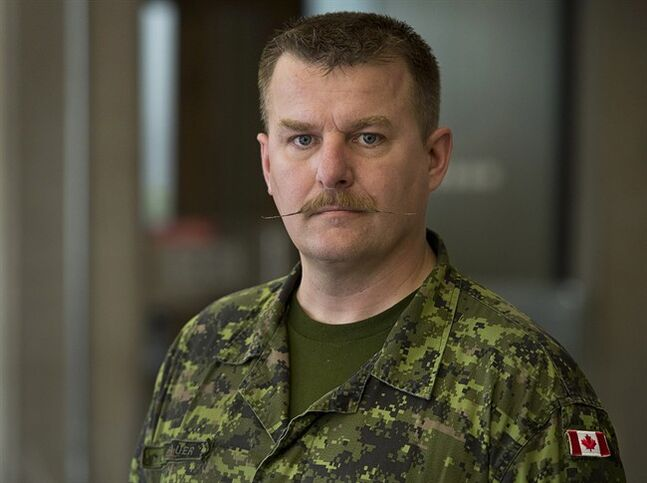 Maj. Marcus Brauer is seen in Halifax on Friday, April 11, 2014. Brauer will be in Federal Court in Halifax on Tuesday, seeking a judicial review of a decision by the Treasury Board Secretariat as he tries to recover thousands of dollars from the federal government he says was lost when he was posted to another city and had to sell his house at a loss.