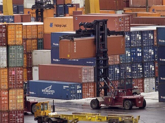 Stevedores move shipping containers in Halifax on Feb. 11, 2009. THE CANADIAN PRESS/Andrew Vaughan