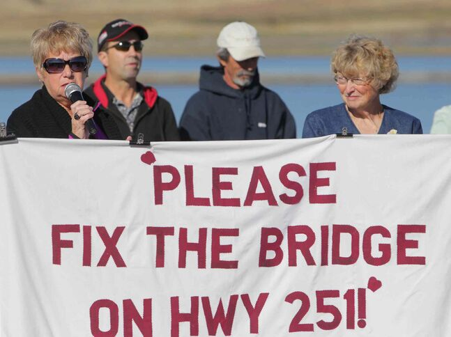 Organizers Betty Miller and Shirley Kernaghan speak during a rally to repair the Highway 251 bridge in this 2011 photo.