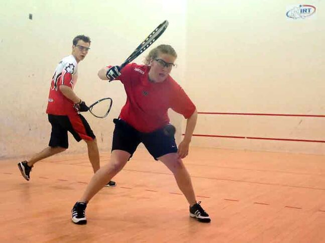 Jennifer Saunders eyes up a shot against Kurtis Cullen during the men's open final at the provincial racquetball finals on Sunday at the Sportsplex.